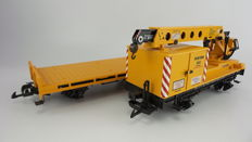 """Spoor G - LGB - 4000/4042 - Crane-wagon with adjustable crane """"Matra"""" which is called upon for maintenance of track, and platform wagon both in yellow livery"""
