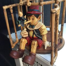 Nice Pinocchio with Jiminy Cricket in cage of polyresin