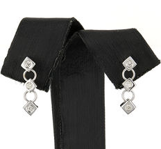 Long white gold earrings with rhombus design and 6 diamond inlay.