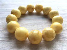 Baltic amber bracelet, egg yolk colour, 29 gr