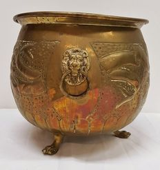 Large copper flowerpot on lion paws feet, with lion heads