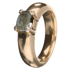 Yellow gold ring set with an oval cut topaz.