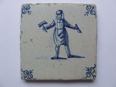 Antique tile with a craftsman.
