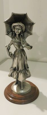 Statue of woman in silver plated porcelain