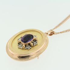 Rose gold necklace with medallion pendant set with amethyst and rose cut diamond.