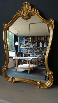 Venetian-style mirror with gilded frame.