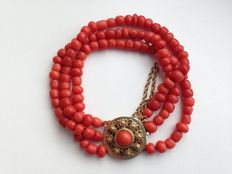 3-strand old-Dutch precious coral bracelet with a gold clasp, filigree tooled