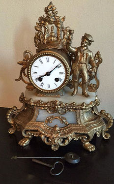 A beautiful clock made of marble and brass, first half of 20th century