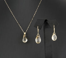 Set of yellow gold chain with pendant and dangle earrings, with citrine quartz gemstones setting.