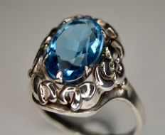 Handcrafted ring with beautiful intensive blue Topaz approx. 3.90 ct..