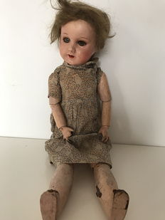 old articulated composition doll France beginning 20th century