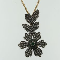 Red gold necklace with gold and silver pendant set with emerald and diamond in flower shape