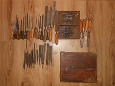 Old wooden box with tools -chisels files ,drills