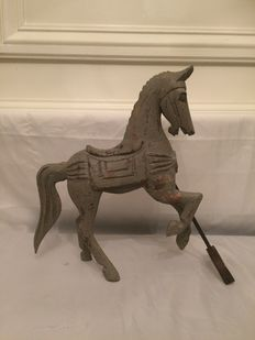 Hand-carved pinewood horse on iron stand