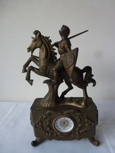 Almost completely mooden mantel clock with gold layer, West Germany, Italy, clockwork Knight on horse, brass, 20th century