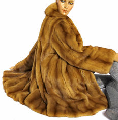 A luxurious genuine weasel fur jacket, soft in a slight swinger look like sable