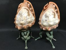 A pair of table lamps made up of cameo worked shells - England, early 20th C