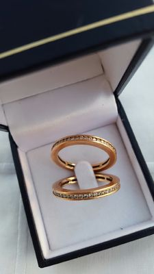 Two rose gold 18 kt (stacking) rings, each with 53 brilliant cut diamonds around, D -SI, per ring 1.02 ct in total.