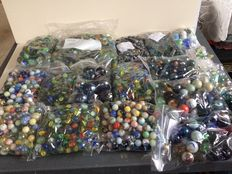More than 15 kilos of glass marbles, selected and counted down in separate bags.