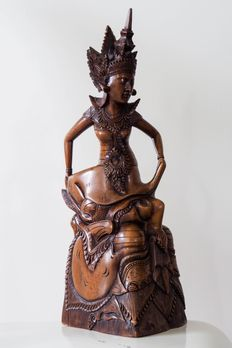 Carved wooden statue of the dancer Batara Giriputri - Bali - Indonesia
