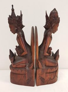 Two wooden bookends of a Balinese god and goddess - Bali - Indonesia
