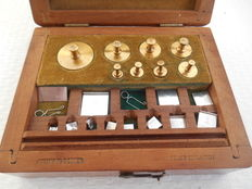 Box with brass pharmacists weights - Holland - approx. 1930