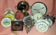 Collection of 3 table clocks and 6 alarm clocks, 1 wall clock