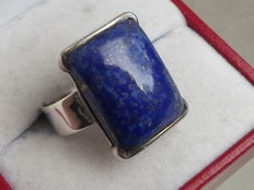 Silver ring with large, natural lapis lazuli.
