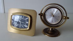 Lot consisting of two small clocks - 1 x UTI (Swiza) ca. 1970 - desk clock - alarm and 1 x Swiza - ca. 1965 - Table clock - alarm. Brass.
