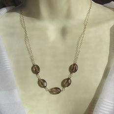 Gold necklace with faceted smoky quartz, smoky topaz