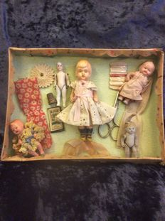 Old German box with sewing attributes, 5 old dress up dolls