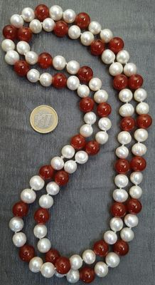 Long necklace composed of large freshwater cultured pearls and carnelian beads.