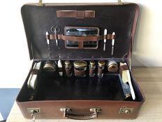 Antique leather travel case with content.