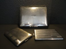 Silver-plated cigar box with wooden inner tray and two silver plated cigarette cases