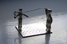 Silver miniature children with kite