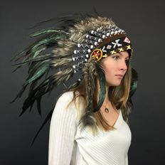 Indian headddress of real feathers and natural materials