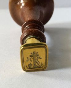 Antique mahogany stamp with faith, hope and love