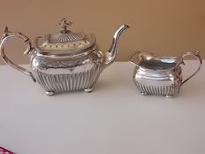 Antique English silver plated teapot and milk jug with beautifully decorated die cast pinnacle, 1834