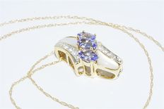 1.75 ct tanzanite, mother of pearl & topaz cluster necklace, 14 kt