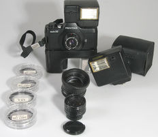 Asahi Pentax Auto 110 Set with 3 lenses, winder, two filters and 4 filters