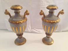 A pair of Baroque carved and parcel gilt wood candleholders - Italy - first half 18th century