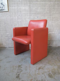 Poltrona Frau, characteristic ox blood red leather armchair