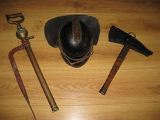 Leather fireman helmet with fire axe and spout. 1st half 20th century