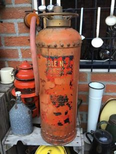 Antique fire extinguisher with rivets from the 1950 's.