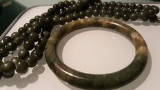 Jade bracelet and necklace as old as 1935, in jade green colour, spinach green