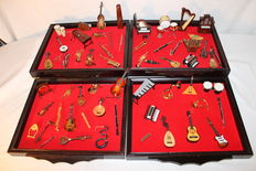 Collection of 60 miniature musical instruments in 4 exhibition cases in wood and red velvet
