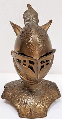 Copper knight head in closed helmet