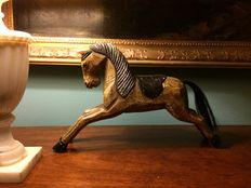 Hand-carved pinewood horse with polychrome decoration
