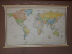 Beautiful as good as new world map in classic style with wooden sticks at top and bottom and suspension cord.pp