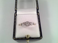 18 kt yellow and white gold ring with 0.10 ct diamond.